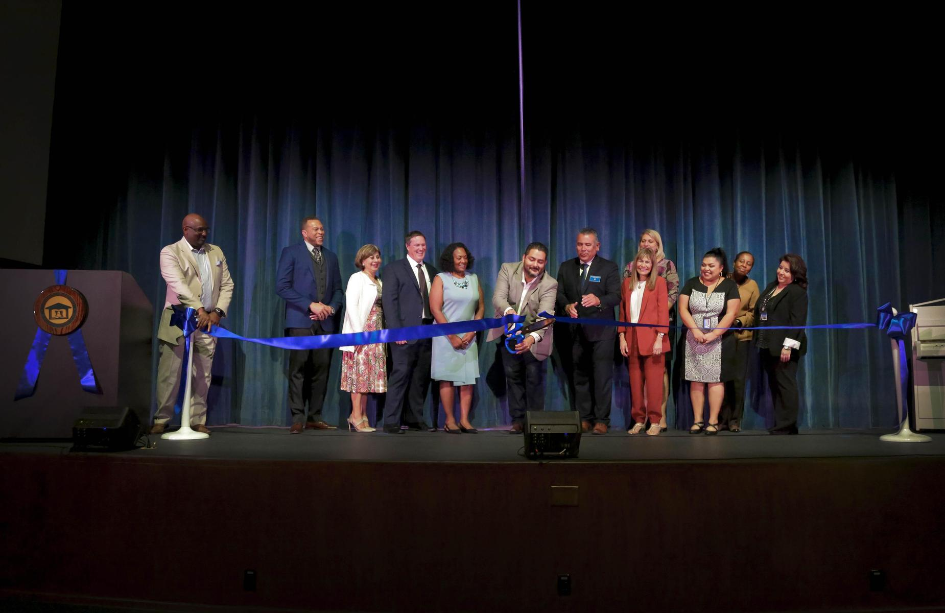 School Board and Administration cut ribbon at the grand reopening of the auditorium