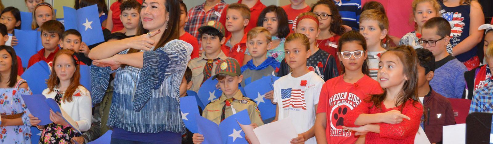 kids singing at veterans day performance