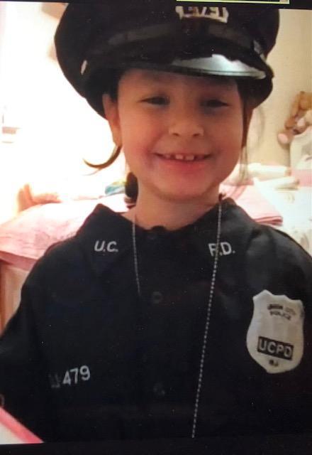 Girl wearing cop uniform