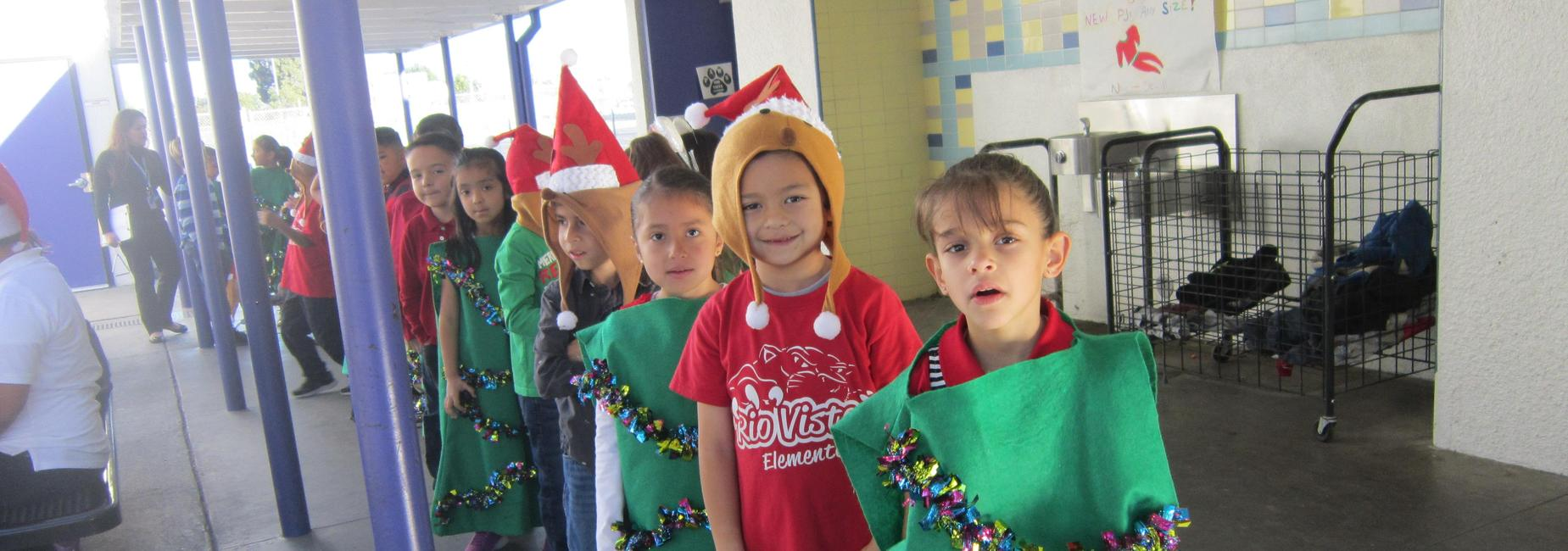 Students stand in line in costume for the Christmas show.