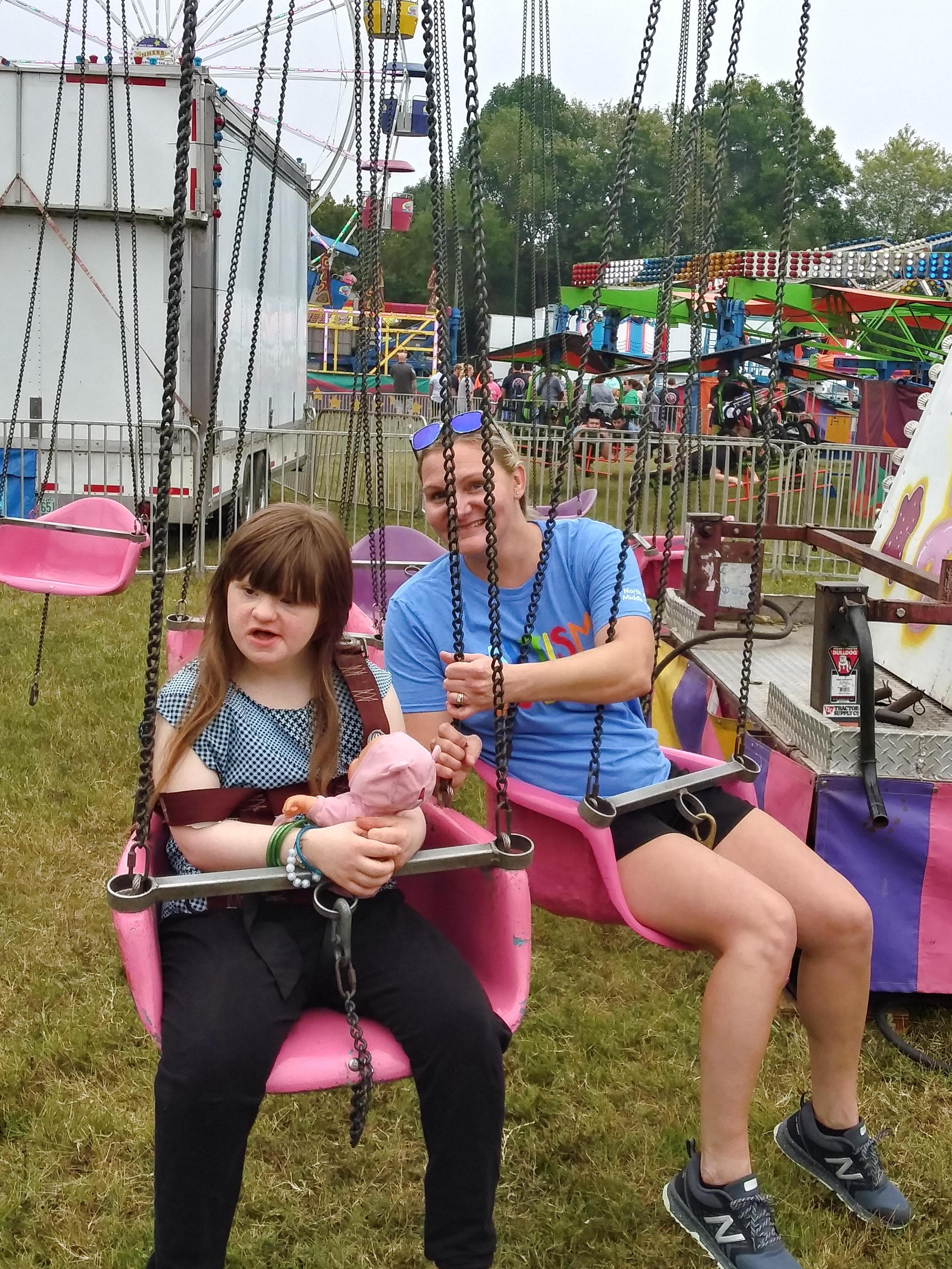 Mrs. G and student riding the swings