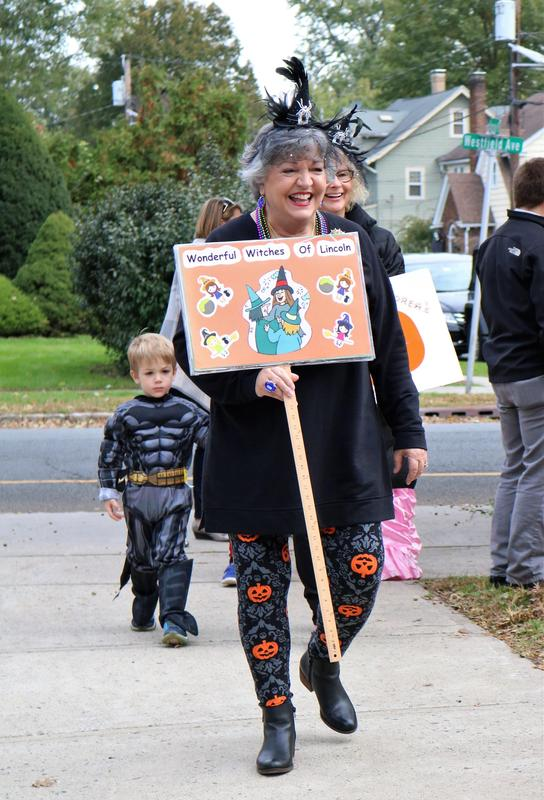Lincoln principal Audrey Zavetz leads Halloween parade.