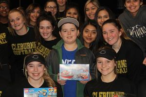 Brody Nelson with softball team