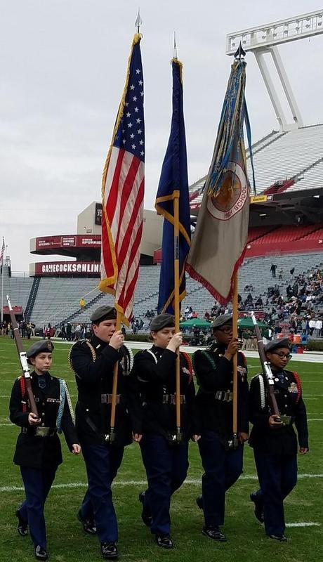 DHS JROTC presenting colors at Williams-Brice Stadium.