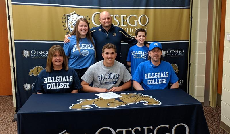 Jaekob with his family and coach Eldred.