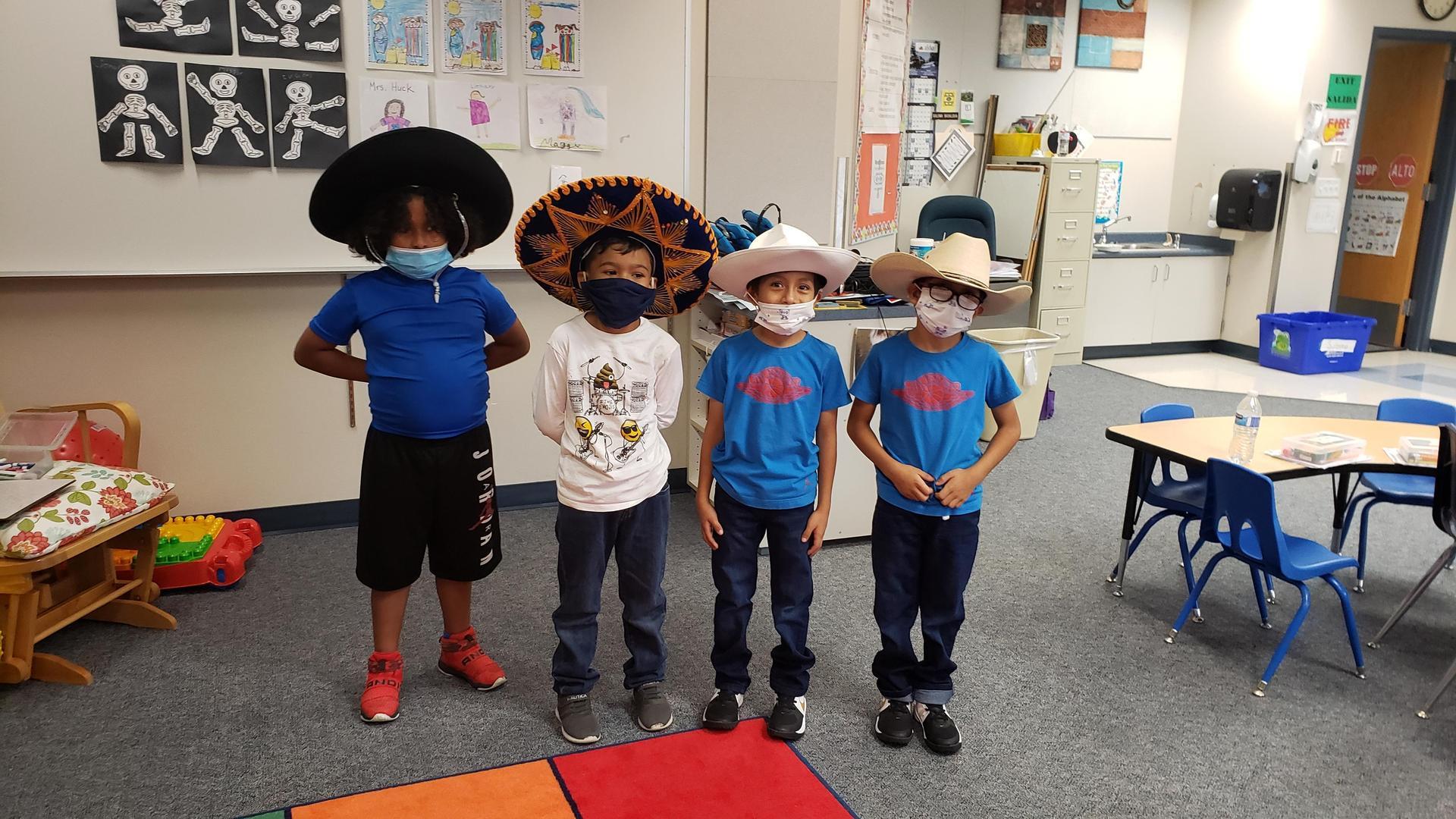 4 boys learning Folkloric dance