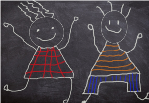 chalkboard drawing of boy and girl