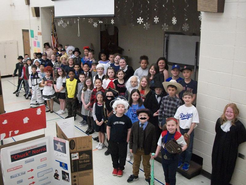 Student presenters at wax museum.