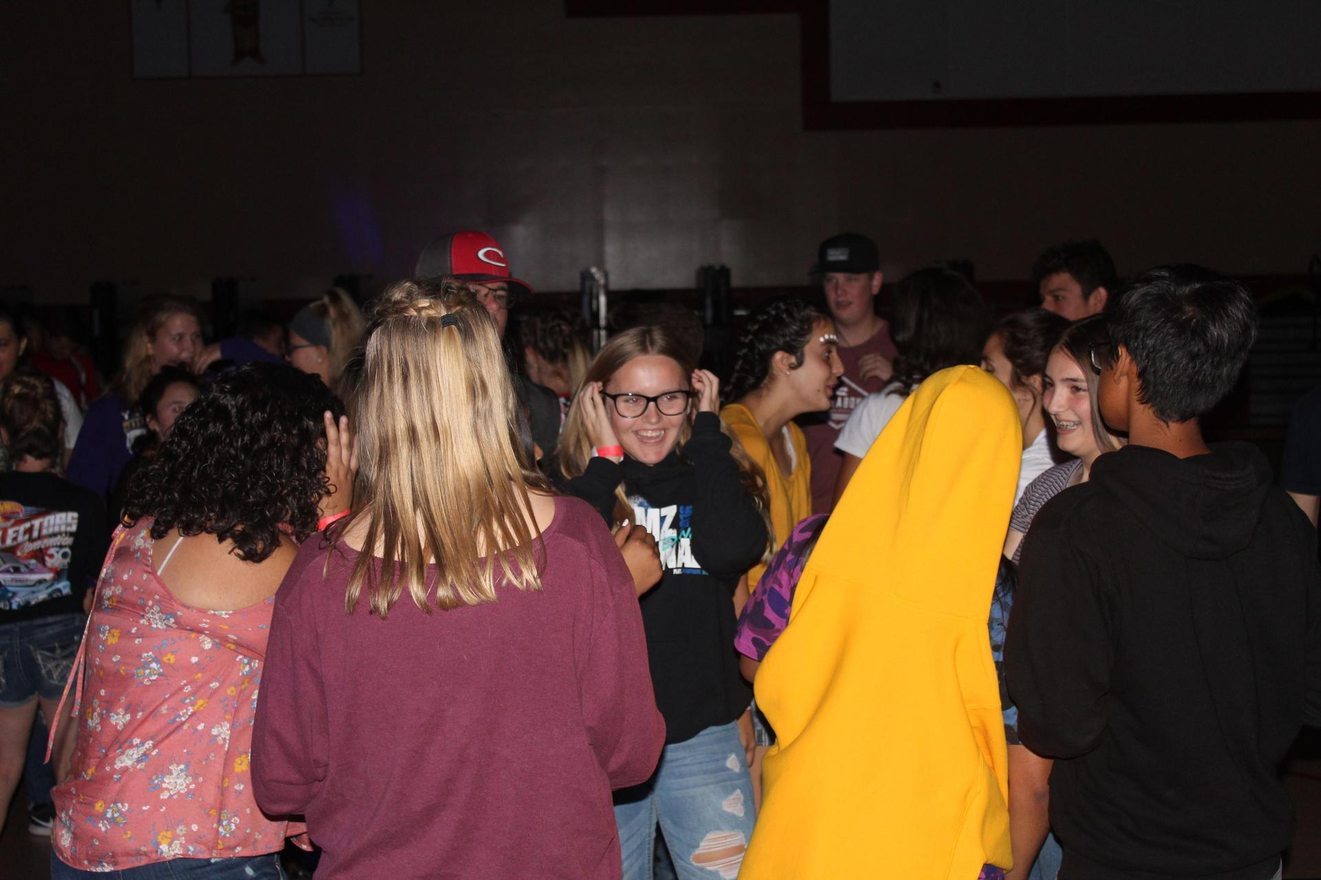 Students having fun at the dance after the Liberty Football game