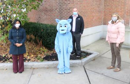 Posed photo, three adults and the Parlin Panther mascot, standing