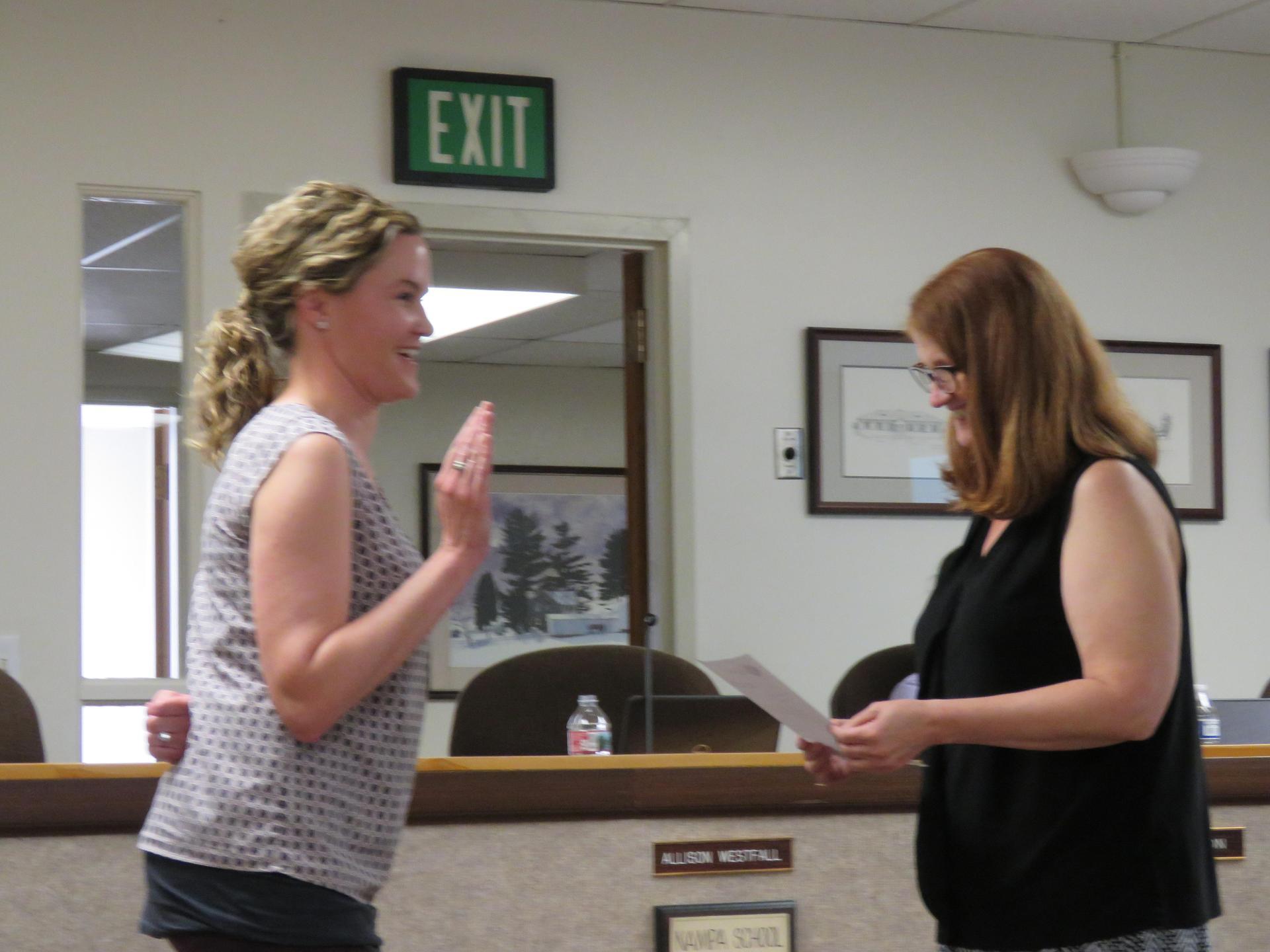 Heather Lewis is sworn in by Allison Westfall