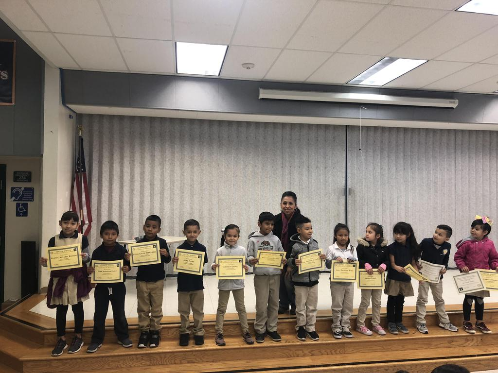 trimester one award winners in Ms. Perez's class pose for picture
