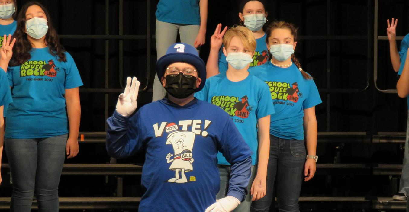 TKMS students hold up three fingers as they sing a song in Schoolhouse Rock Jr. musical.
