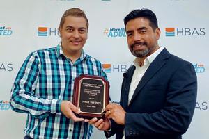 Principal Steve Curiel presents Jorge with the award.