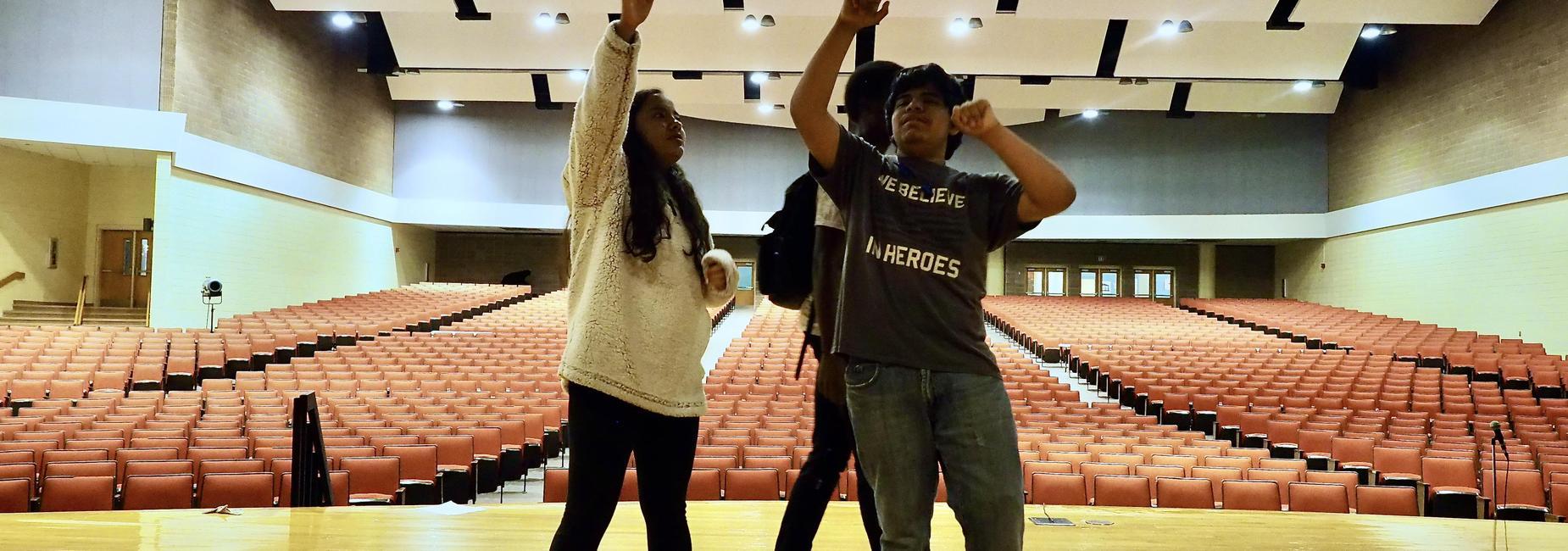 drama students in auditorium