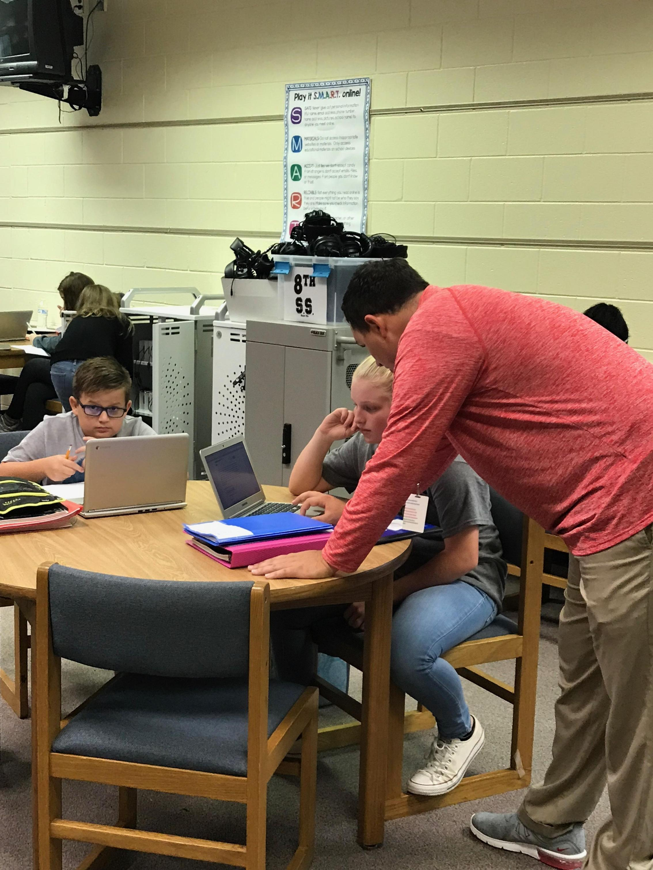 Mr. Smith helping students