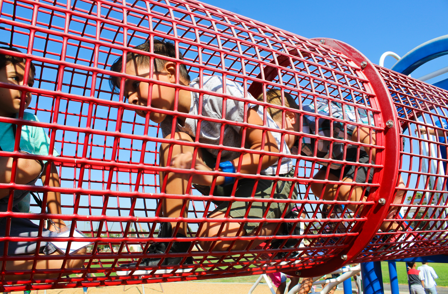 A student playing on the jungle gym.