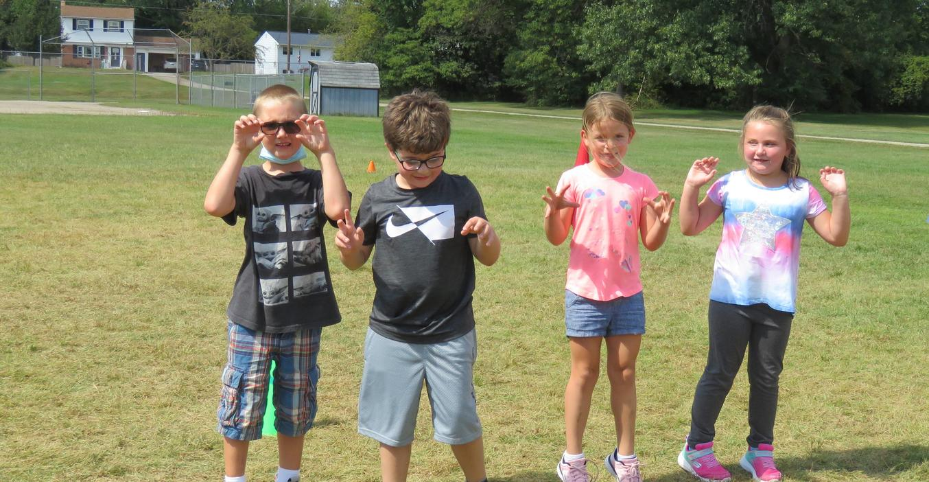 McFall students pretend to be monsters in a PE game.