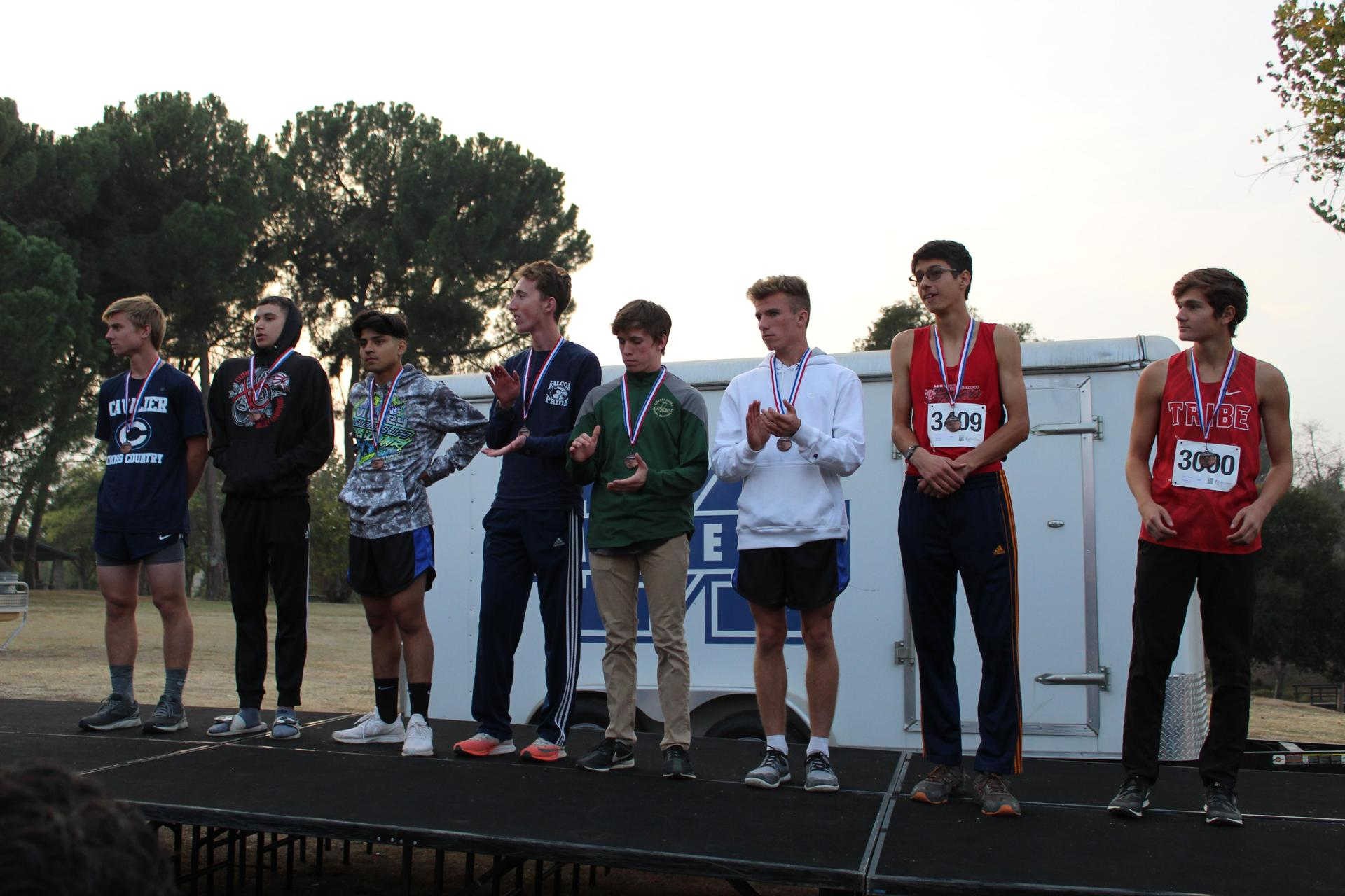 CUHS runners receiving their individual awards.