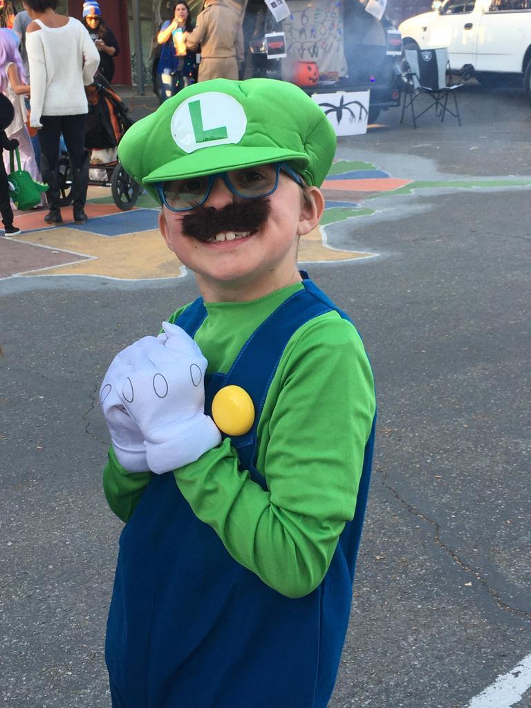 child dressed up as luigi from mario bros