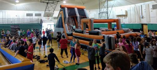 Picture of kids playing on giant inflatables.