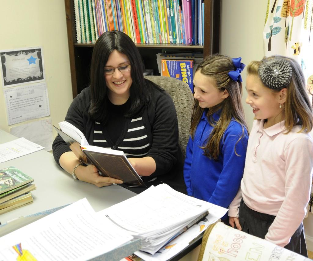 Morah Roth learning with two girls