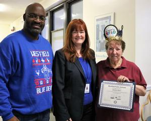 Westfield High School principal Dr. Derrick Nelson and Westfield Public Schools Superintendent Dr. Margaret Dolan pose with Anita Russo, who retired in December after more than 48 years as a cafeteria worker at WHS.