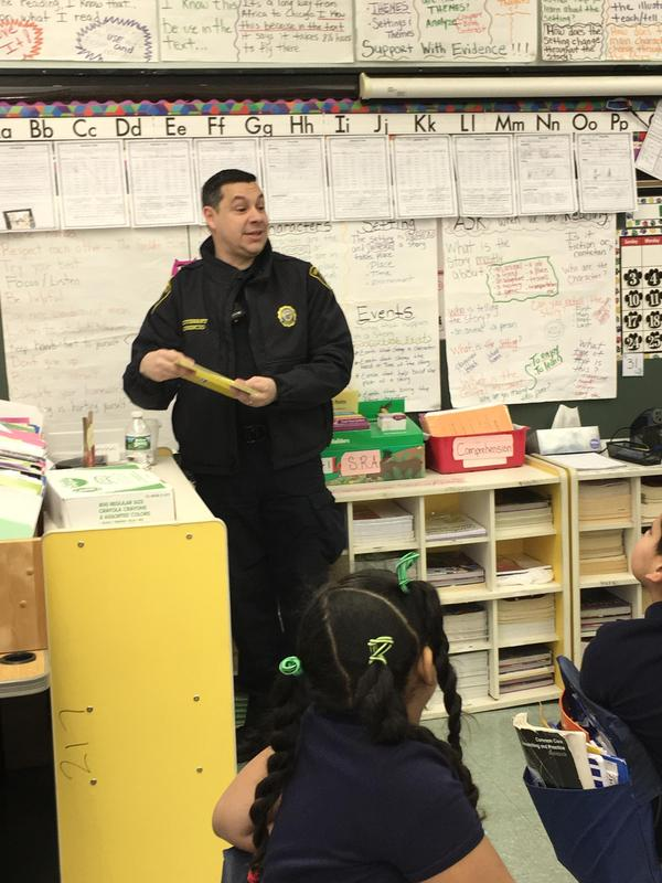 Lt. Walter reading to students at Edison School