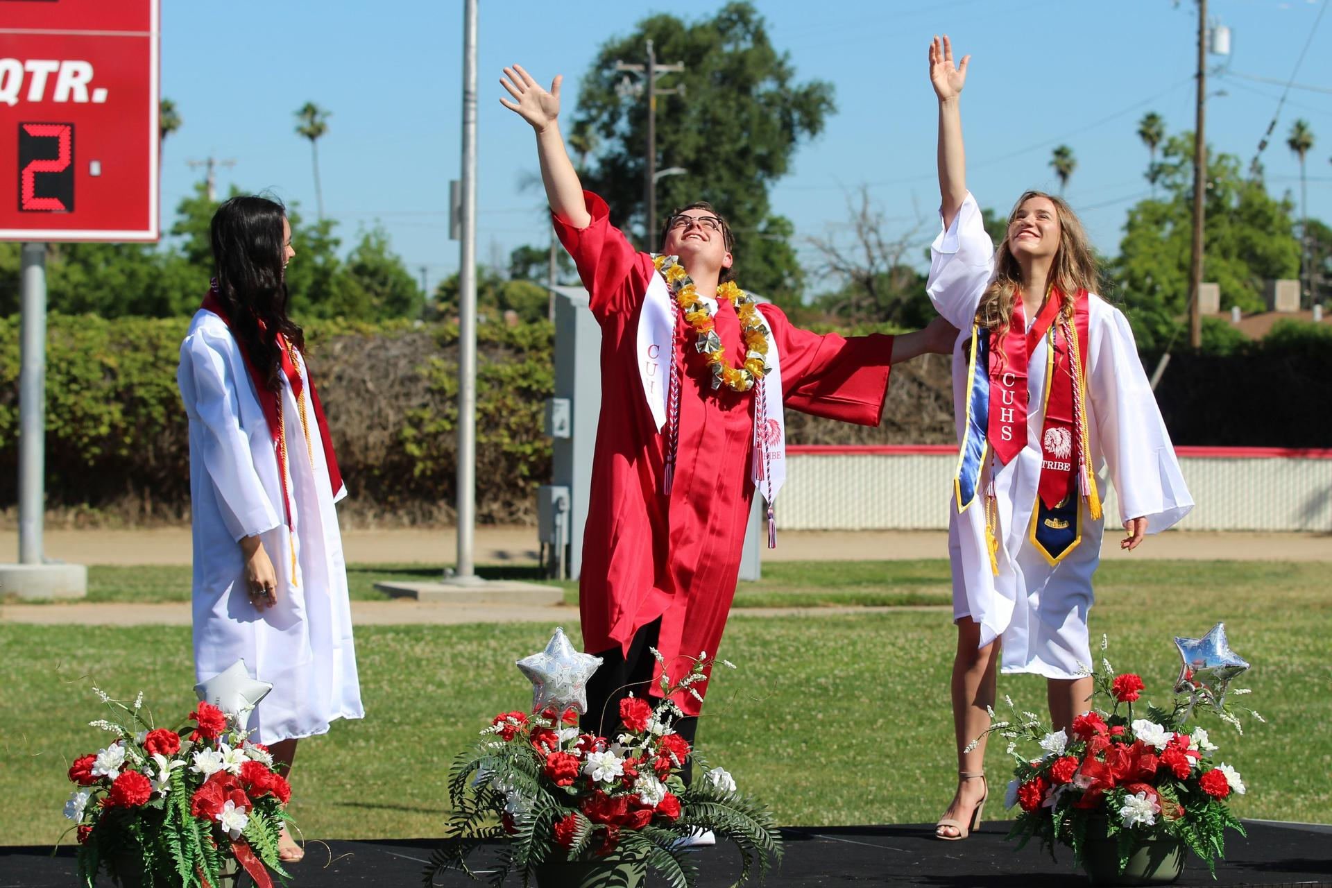Left to right, Class President Andrea Jimenez, ASB Co-President Noah Linhares, and ASB Co-President Christina Fuller lead the Class of 2020 in the turning of the tassels