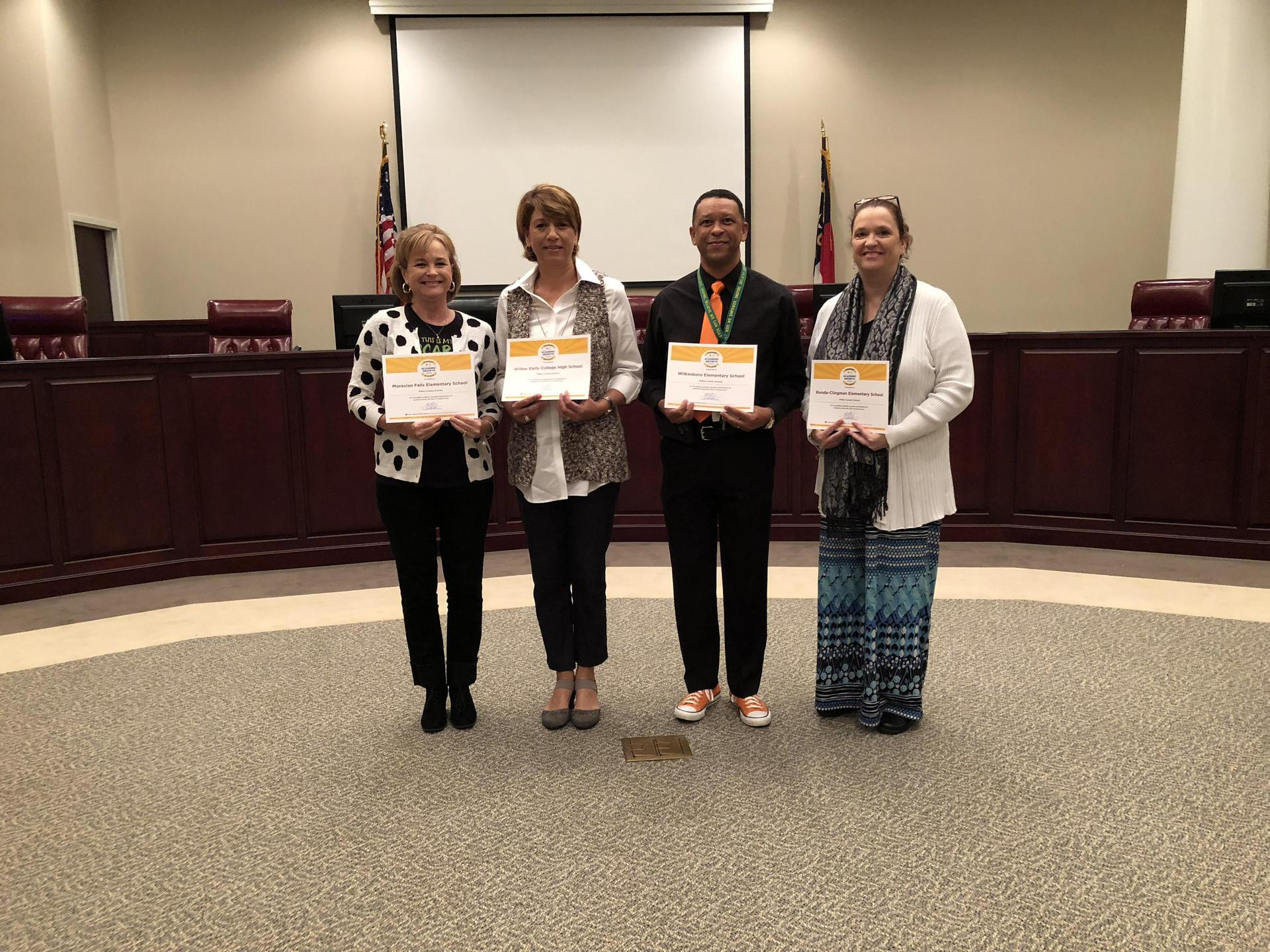 Principals from MFES, WECHS, WES, and RCES recognized for Exceeding Expected Growth