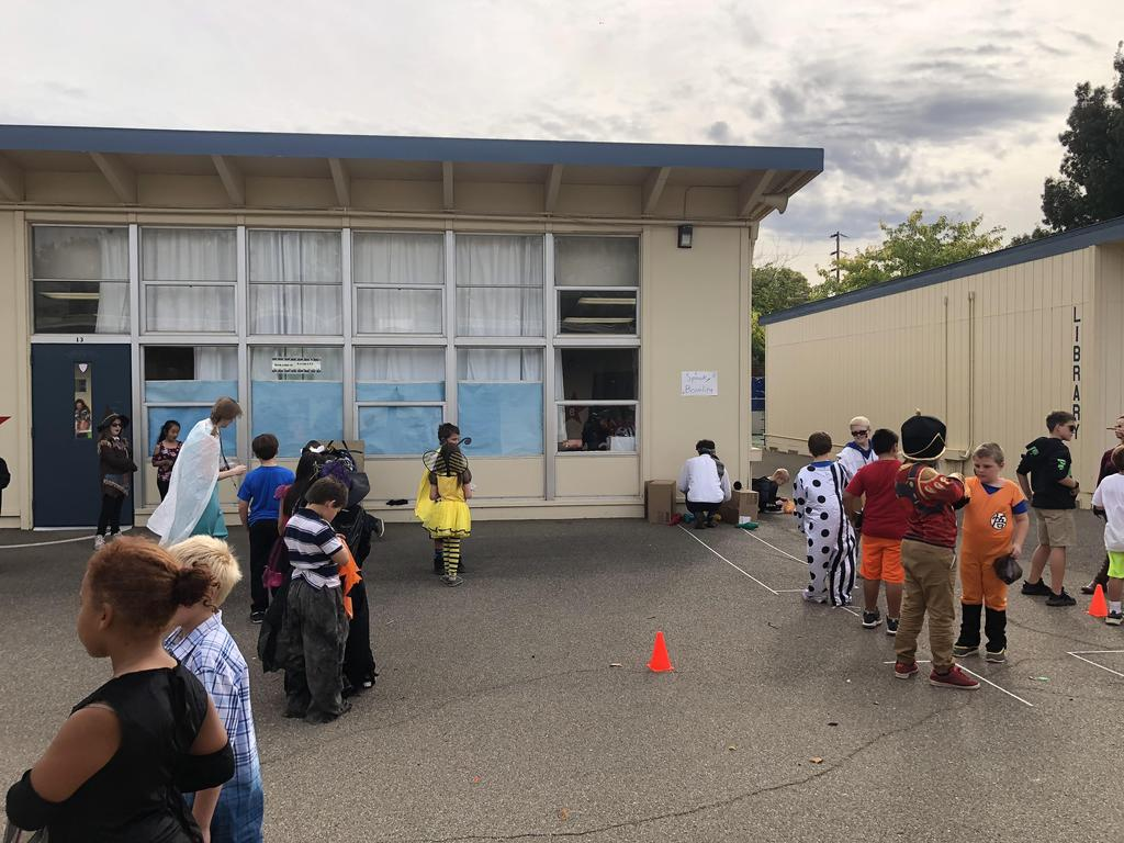 The whole school playing carnival games during the Fall Festival