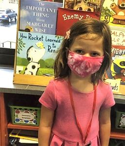 Photo of Wilson student wearing pink mask that matches her dress.