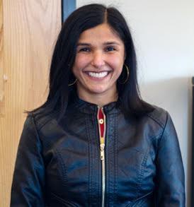 Informal photo, Priya, smiling widely