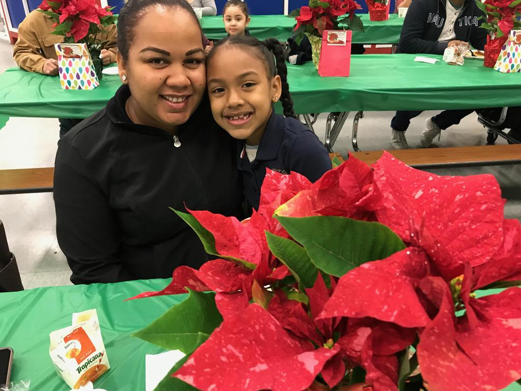 mother and daughter enjoying the student of the month breakfast