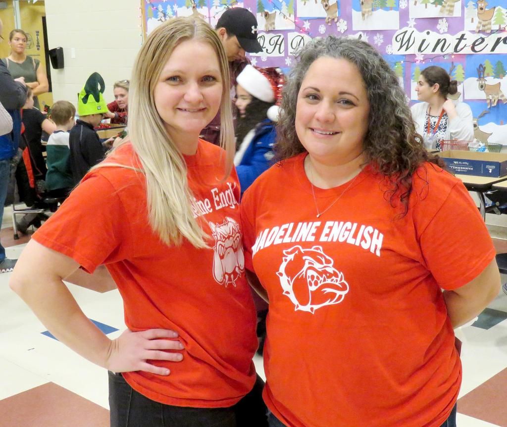 Two members of the PTO, in bright-red Madeline English T-shirts