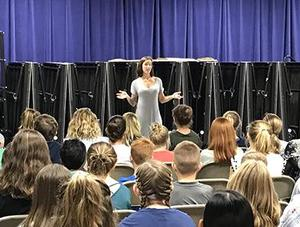 Ms. Strosnider tels her story at James RiverDay School's middle school Friday morning meeting.