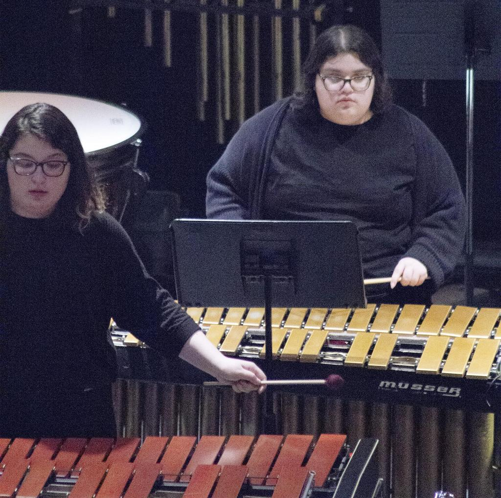 A close-up of two members of the percussion ensemble