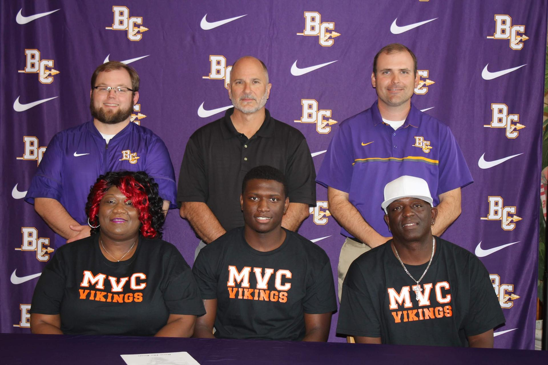 Darryl Harris with parents and coaches at signing day