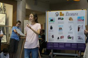 A student presenting her studies at the culminating event at the school.
