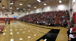 John Schieche speaking to a crowd of more than 400 East Valley employees in the East Valley High School gymnasium.
