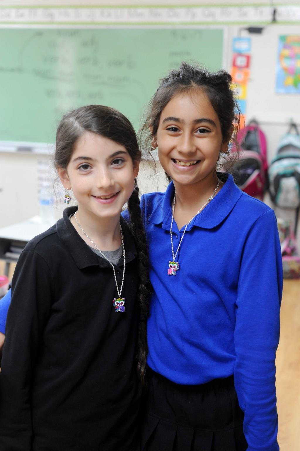 girls smiling together
