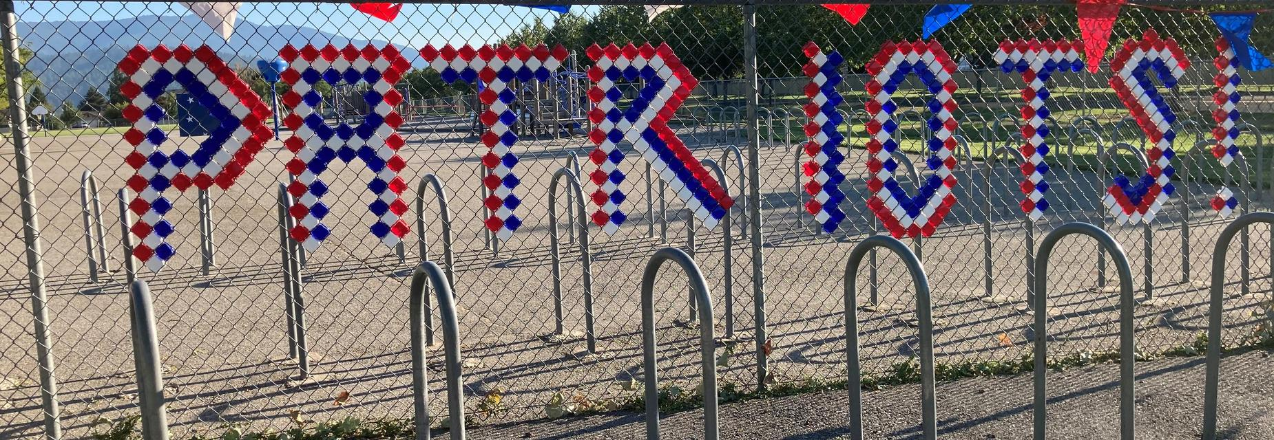 Patriots- in the fence line on the playground