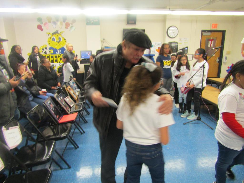 veterans proudly give his daughter a hug