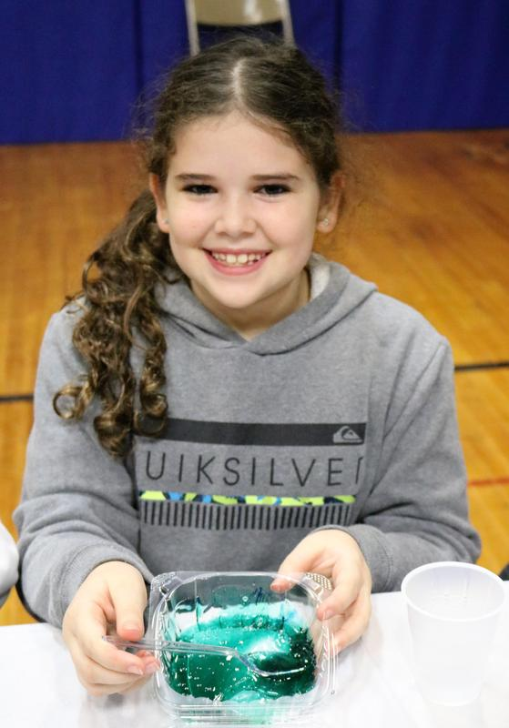 McKinley 4th grader Maya Spiewak has fun learning the science of slime at the school's 6th Annual STEAM Night on Jan. 24.