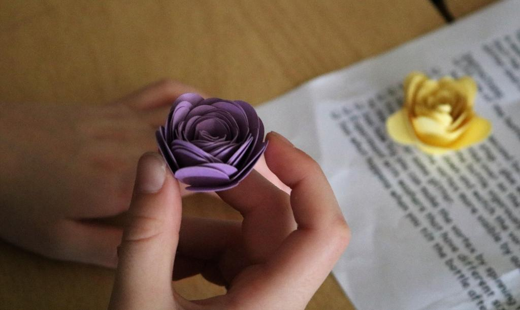 Photo of closeup of intricate paper in shape of flower,cut by machine during STEAM Day.