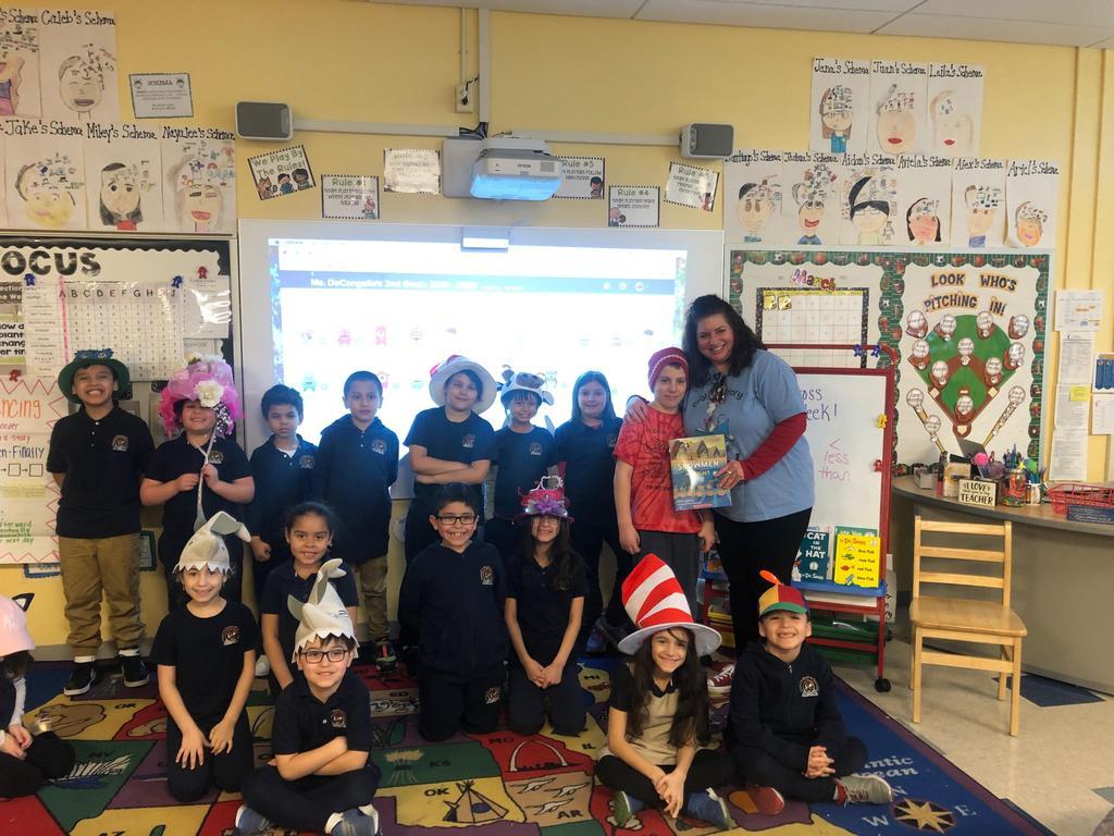 teacher with her class wearing wacky hats