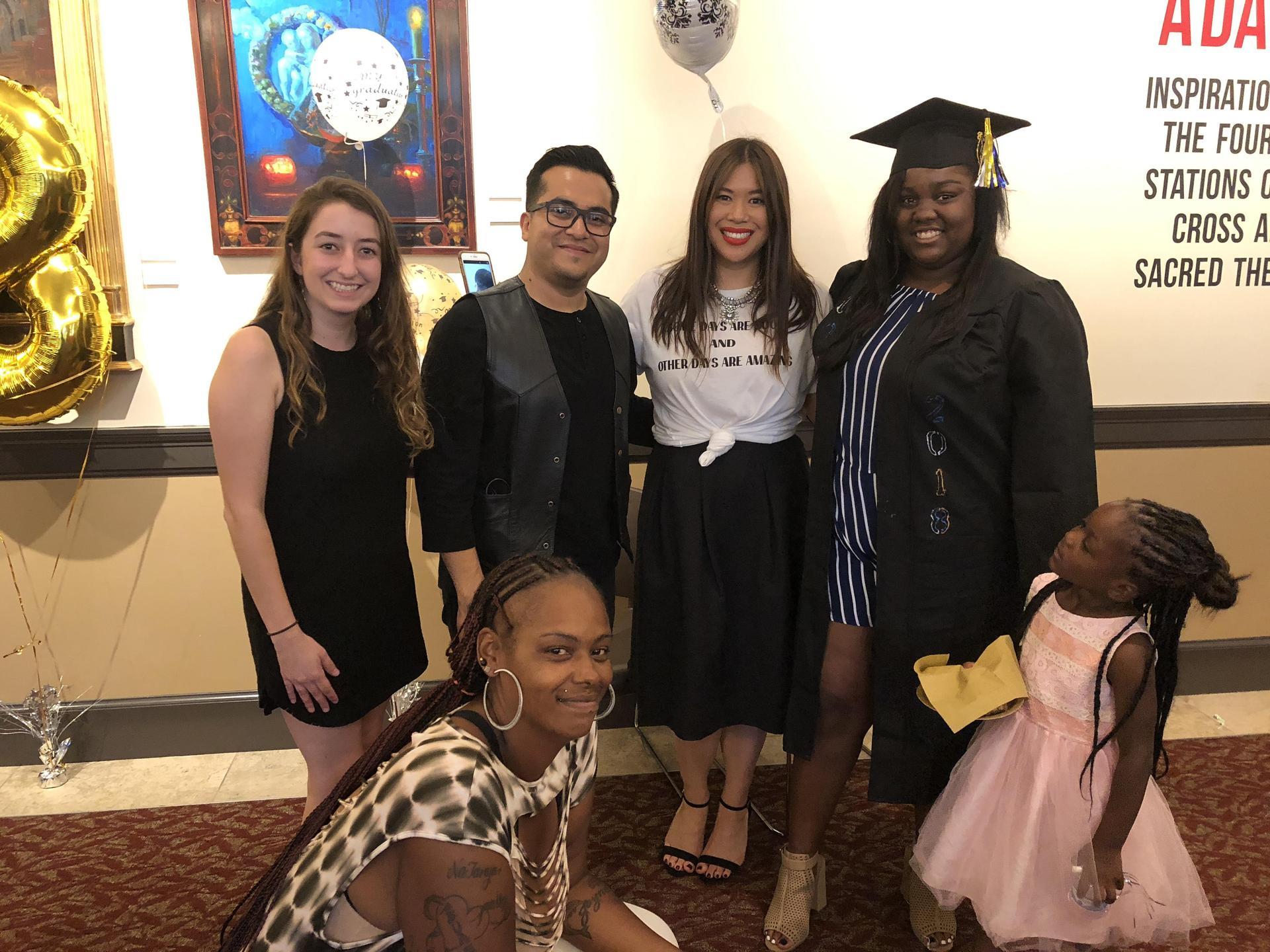 Avalon staff pose with a graduate
