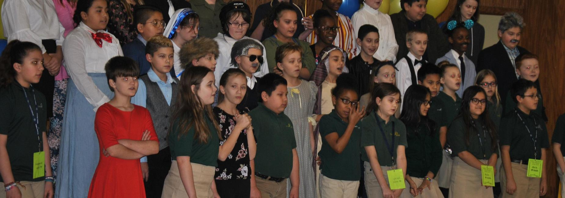 elementary and middle school choir singing