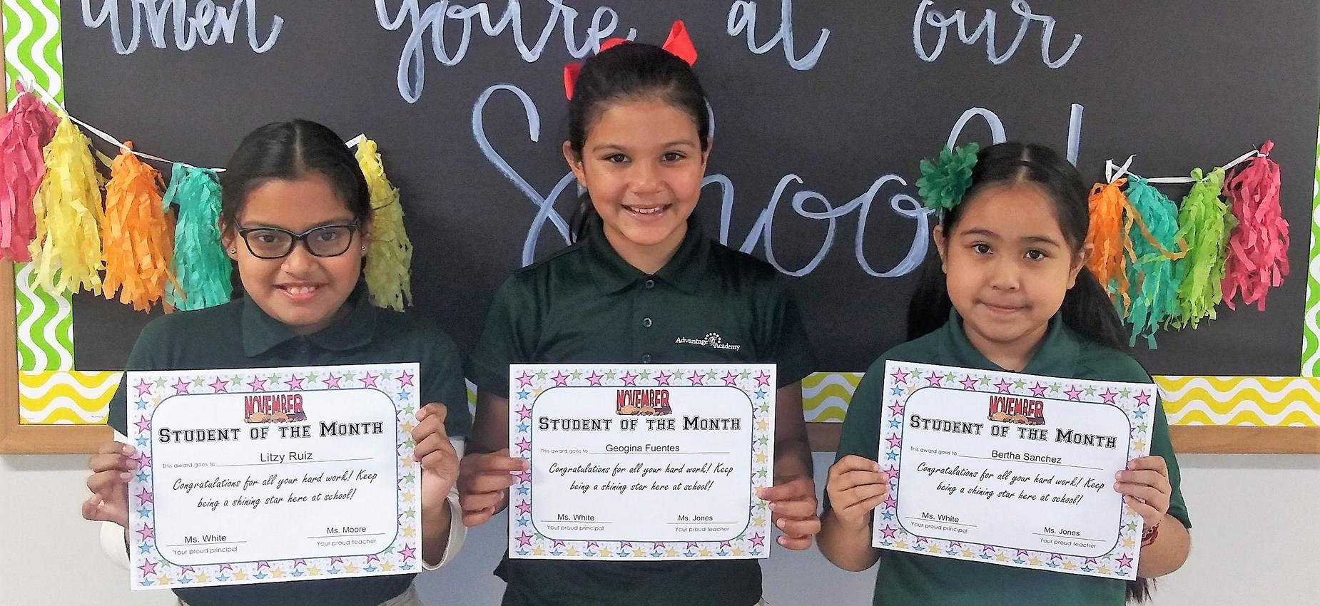 3 girls holding certificate awards in school uniform