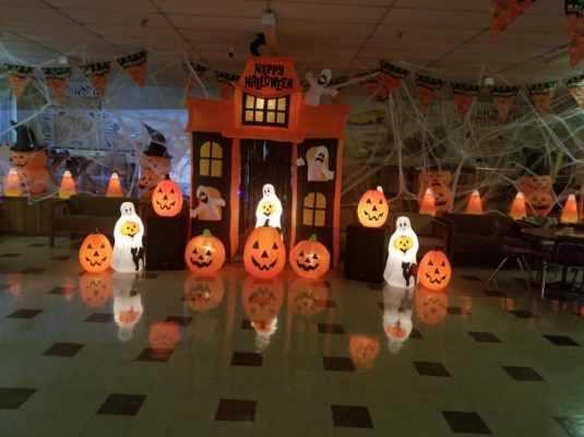Glowing pumpkin and ghost decorations in the dormitory